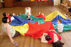 Action Kids activities with parachute
