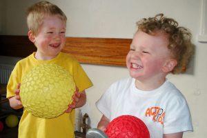 children doing action kids