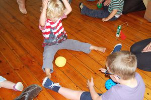 kids playing with balls in Action Kids